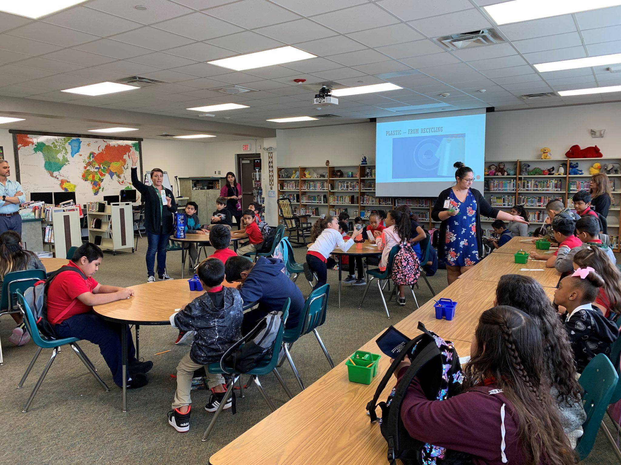 EWS educator teaches the Freeman Elementary STEAM Club about recycling